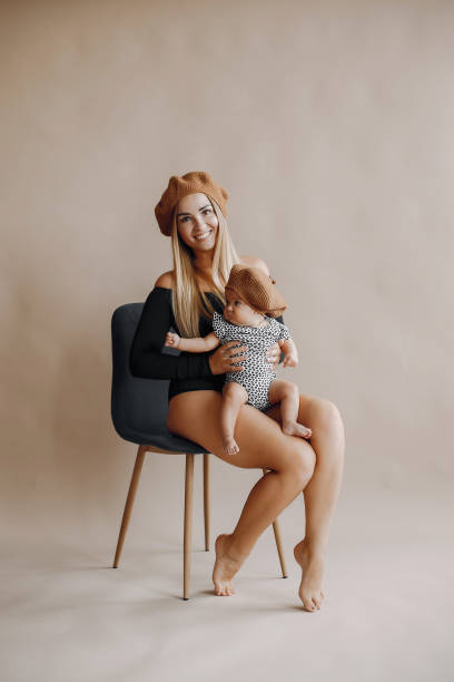 Elegant mother with cute little daughter in a studio stock photo