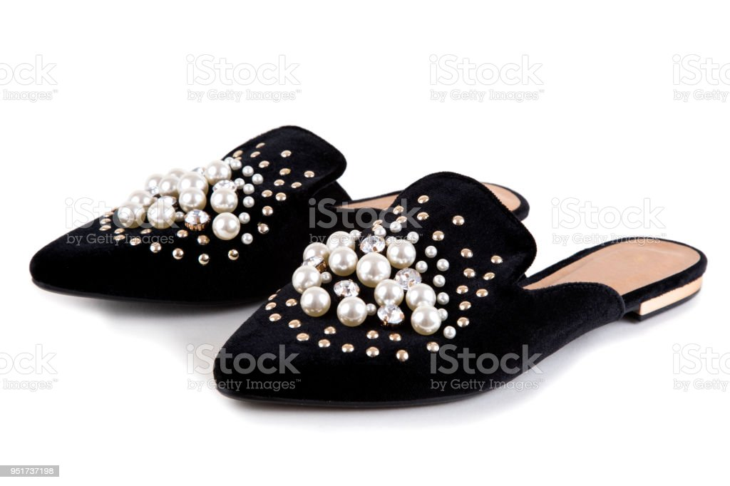 Elegant mule shoes with pearls and rhinestones stock photo