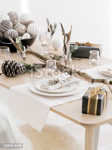 1059144984 istock photo Elegant natural design of New Year table setting. 1030314358