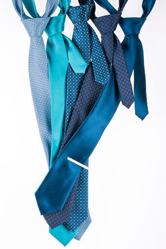 Five silk ties turquoise color on a white background