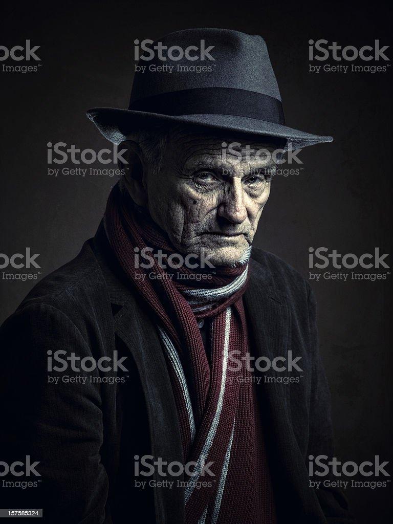 elegant old man staring a camera stock photo