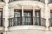 Street view of the elegant facade of an old apartment building in a residential neighborhood of Istanbul. Vintage style photo.