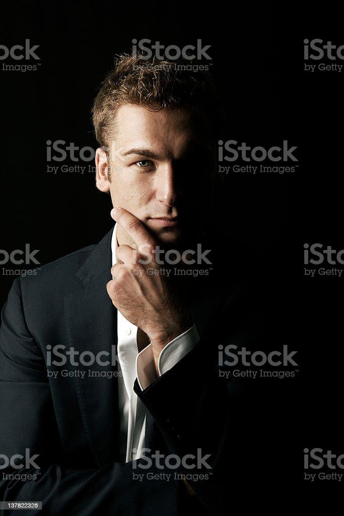 Elegant Pensive Male Beauty. Black Background. Color Image stock photo
