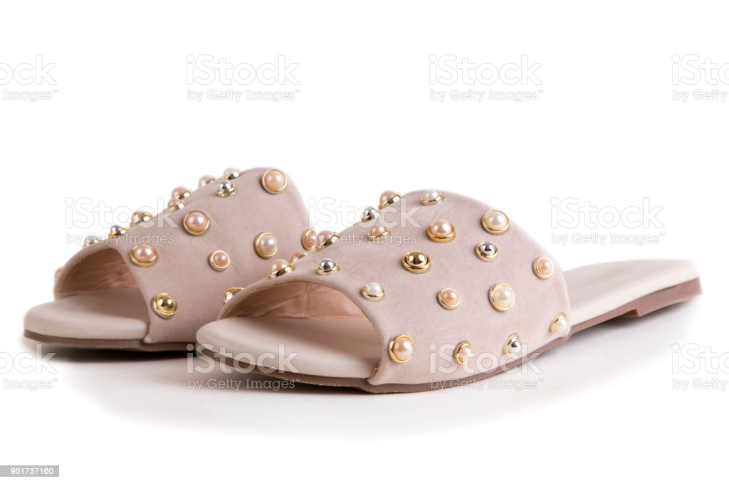 Elegant pink mule shoes with pearls stock photo