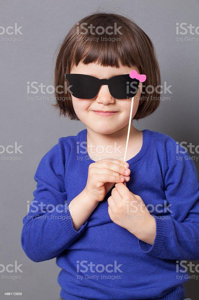 a14413e47051 elegant preschooler wearing paper sunglasses for kid eye protection  metaphor royalty-free stock photo