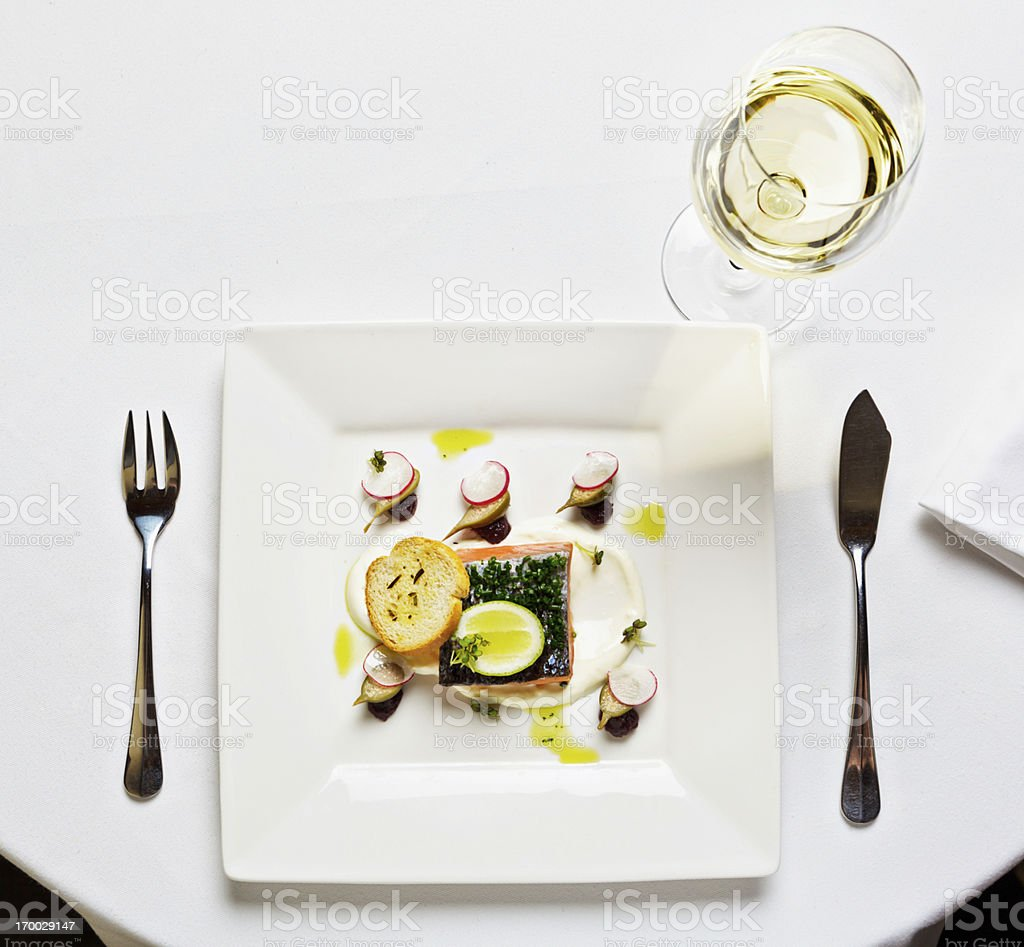 Elegant restaurant version of a square meal! Salmon entree stock photo