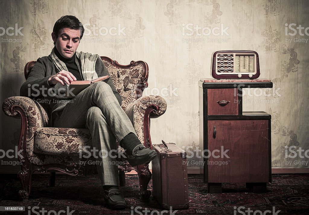 Elegant Retro Man Reading a Book in Vintage Room stock photo