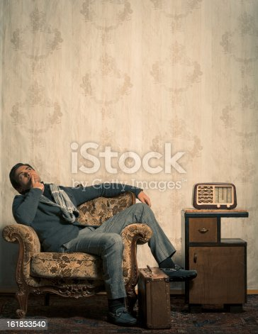 istock Elegant Retro Man Sitting in Vintage Room with Copy Space 161833540