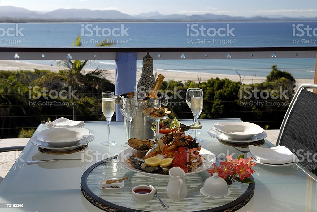 Elegant seafood dinner setting for two overlooking the bay stock photo