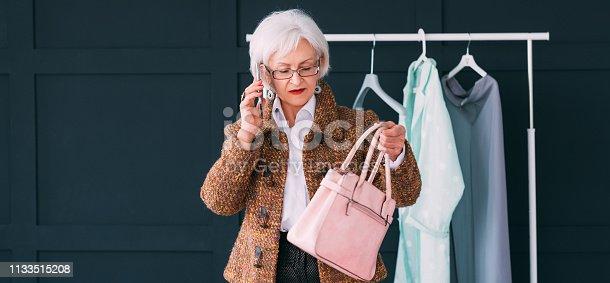 1133515238 istock photo elegant senior lady wardrobe consultant copy space 1133515208