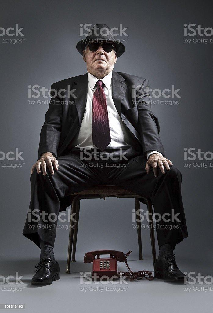 elegant senior man waiting for a phone call royalty-free stock photo