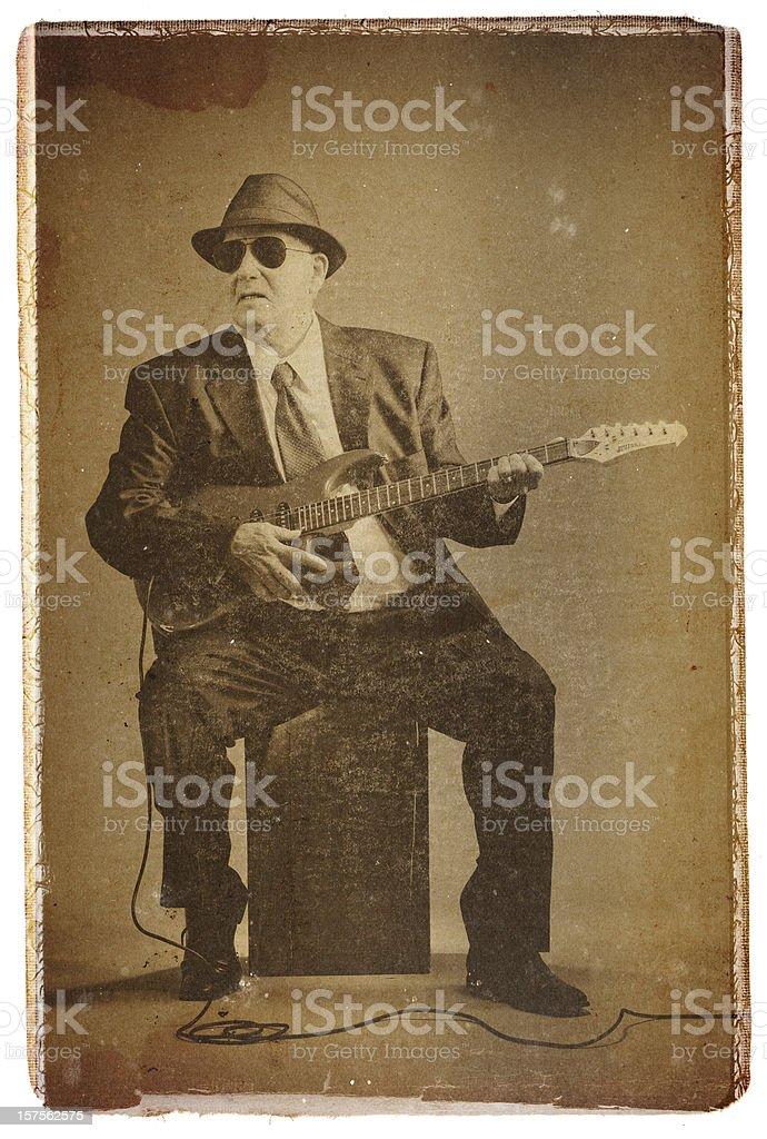 elegant senior playing an electric guitar royalty-free stock photo