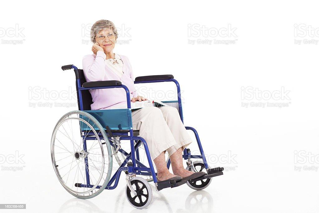 elegant senior woman sitting on wheelchair royalty-free stock photo