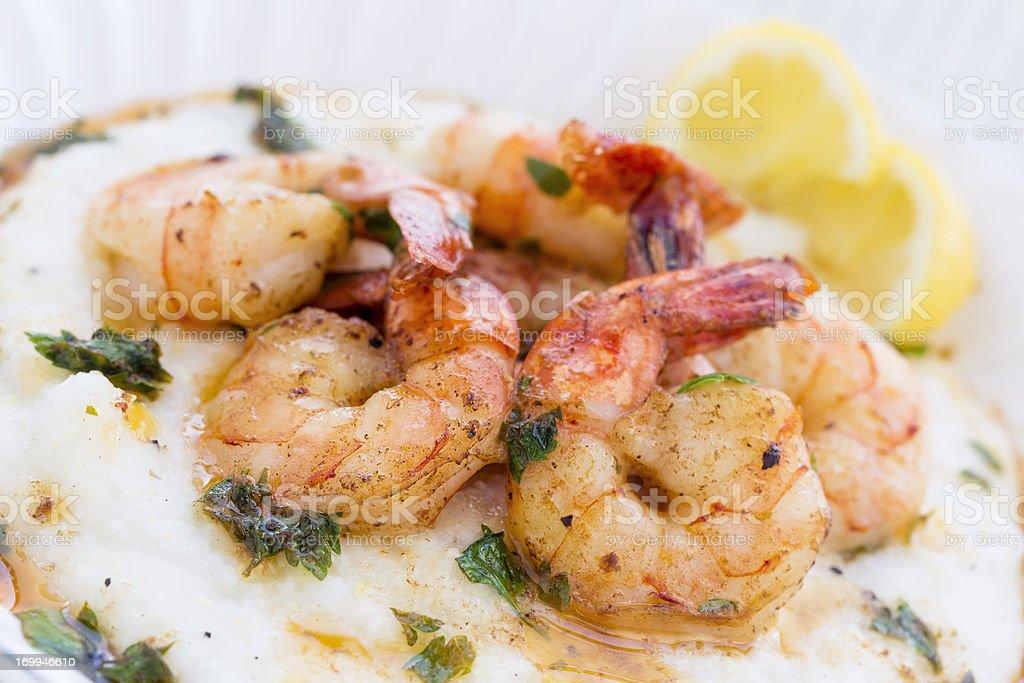 Elegant shrimp and grits served on white plate  stock photo