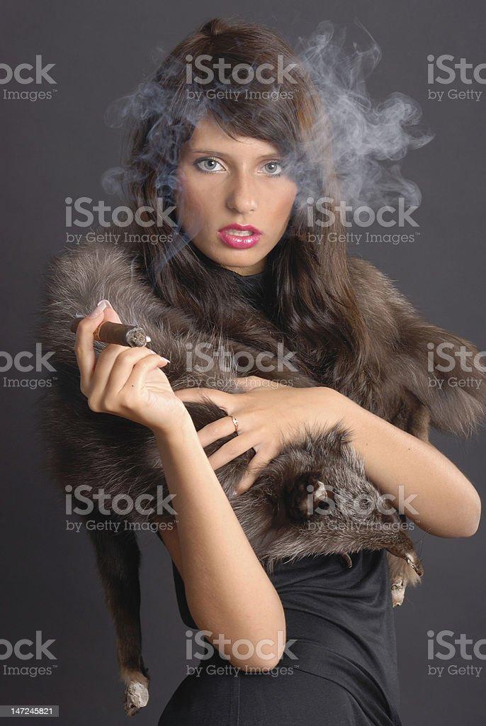 Elegant smoking woman royalty-free stock photo