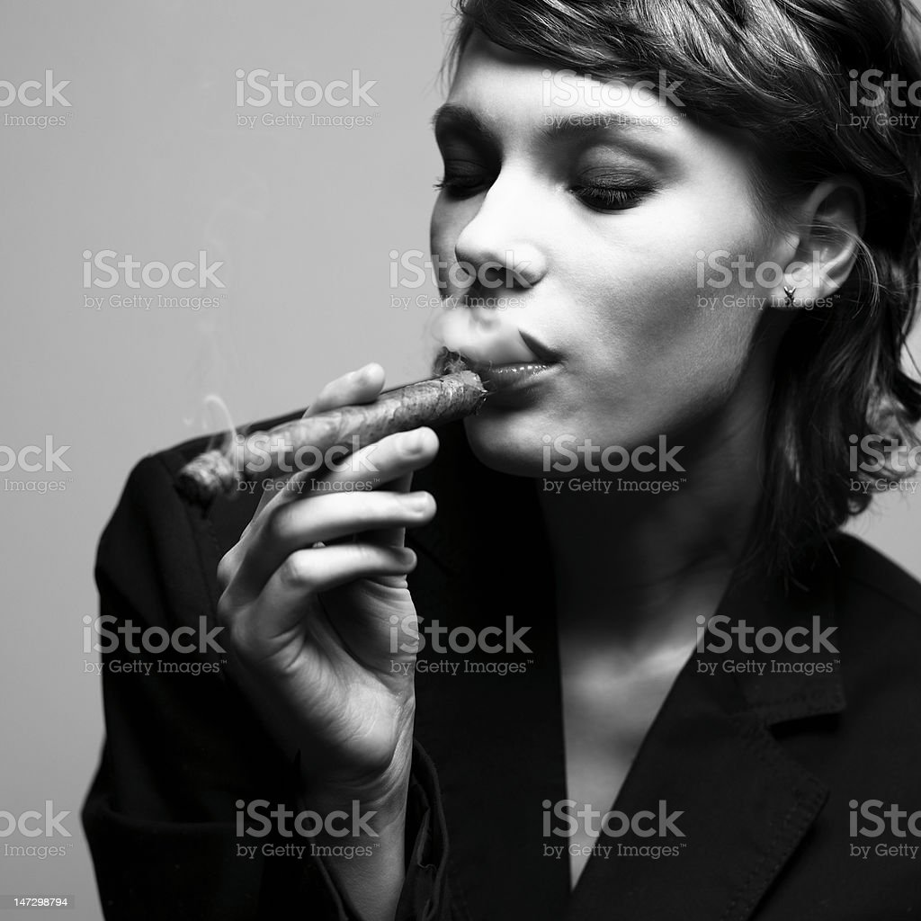 Elegant smoking woman stock photo