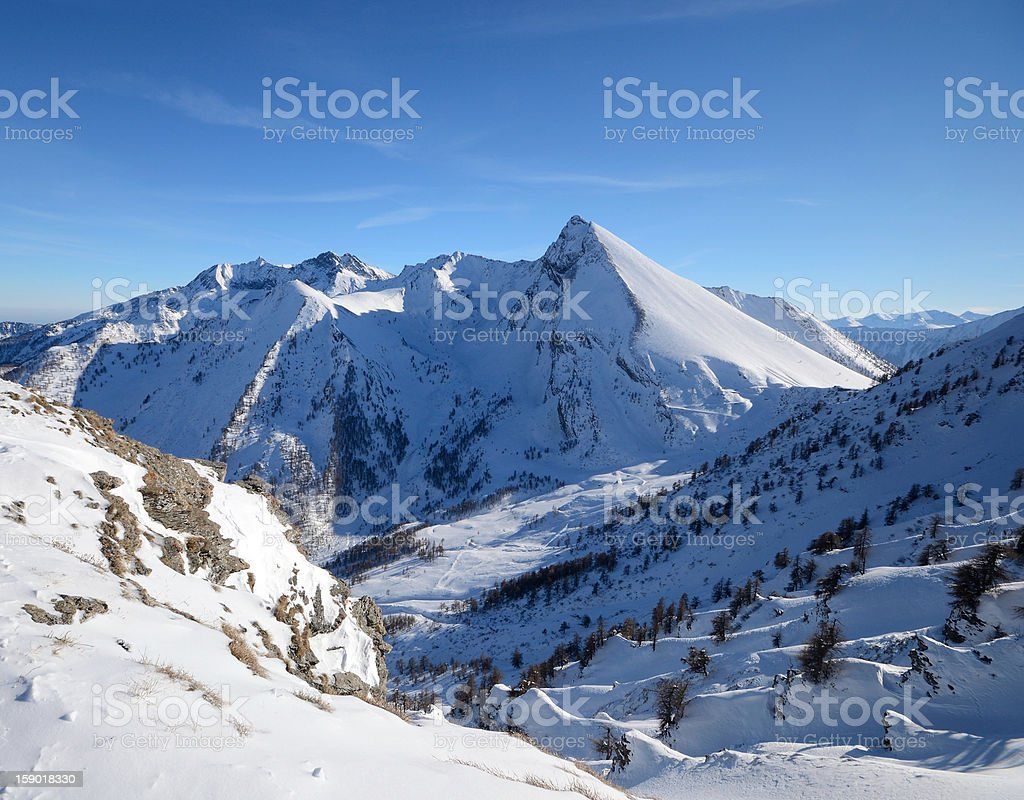 Elegant snowcapped mountain peak royalty-free stock photo