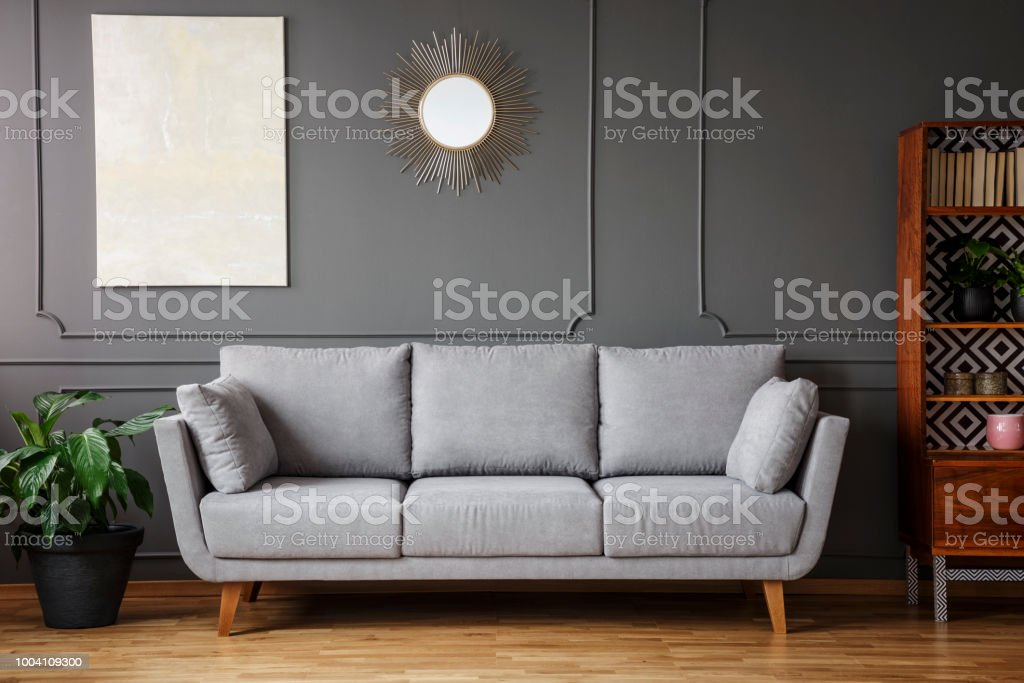 Elegant Sofa Between A Plant A Wooden Cupboard In A Living Room Interior  With A Painting And Mirror On The Wall In A Living Room Interior Stock  Photo ...