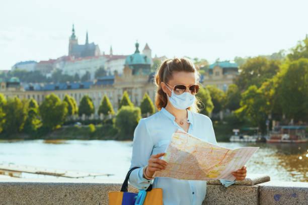 elegant solo tourist woman sightseeing outdoors on city street stock photo