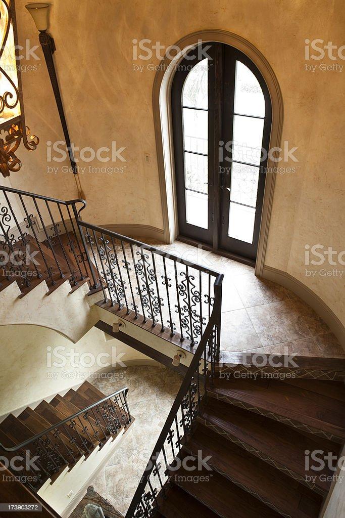 Elegant Staircase Inside an Italian Influenced Estate Home royalty-free stock photo