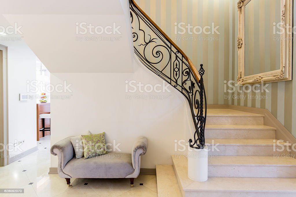 Elegant staircase with decorative railing stock photo