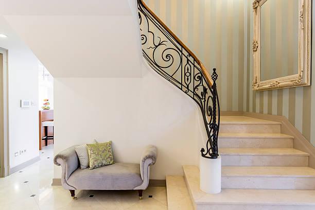 Elegant staircase with decorative railing - foto de stock