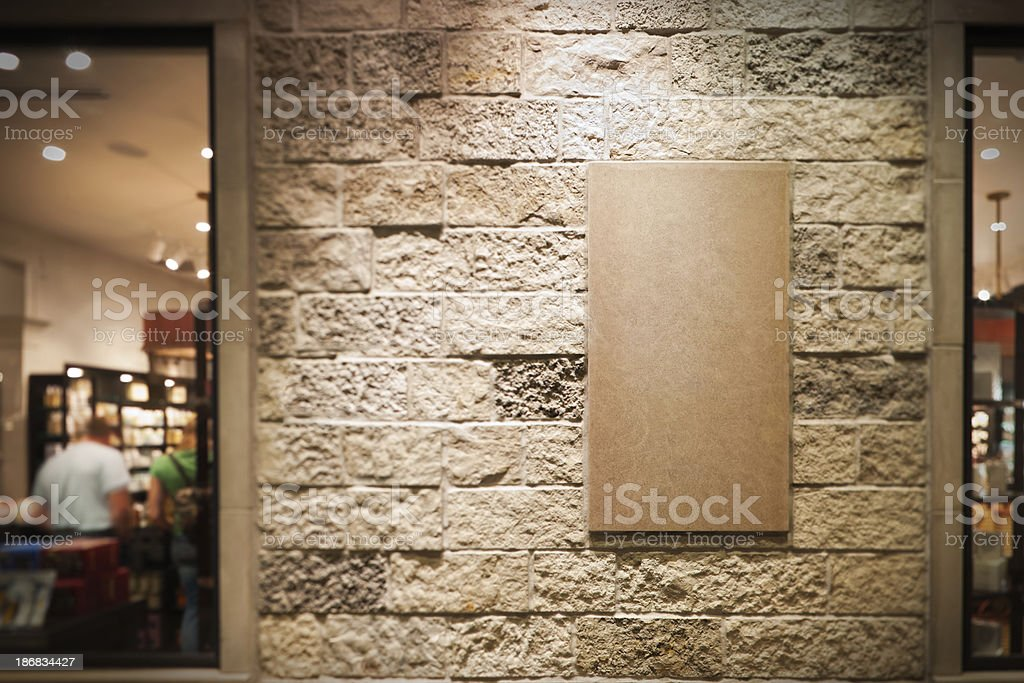 Elegant stone storefront with decorative plaque sign. royalty-free stock photo