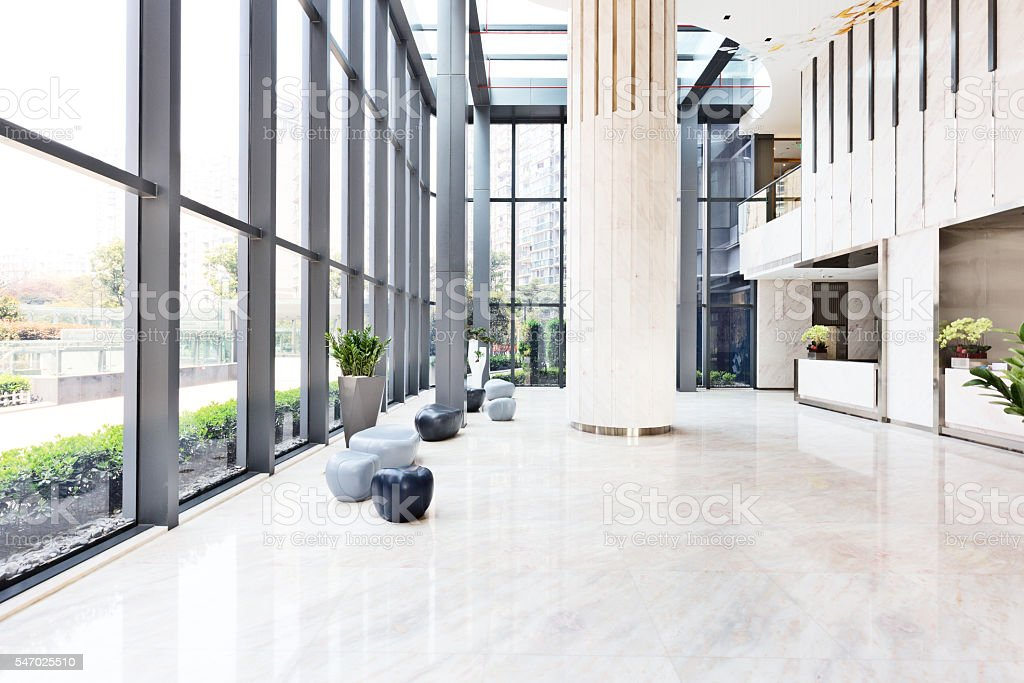 elegant stools and talbe in huge and bright hall stock photo