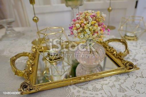 istock Elegant styling golden decoration for wedding function 1048046366