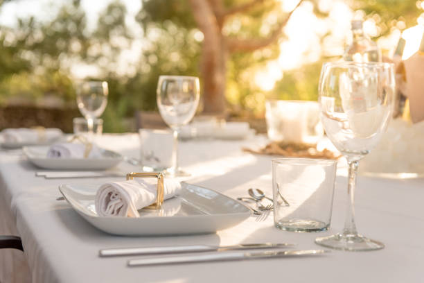 Elegant table for dinning at sunset stock photo