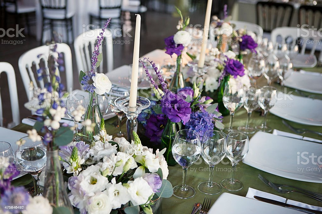 Elegant table setting during a wedding reception stock photo