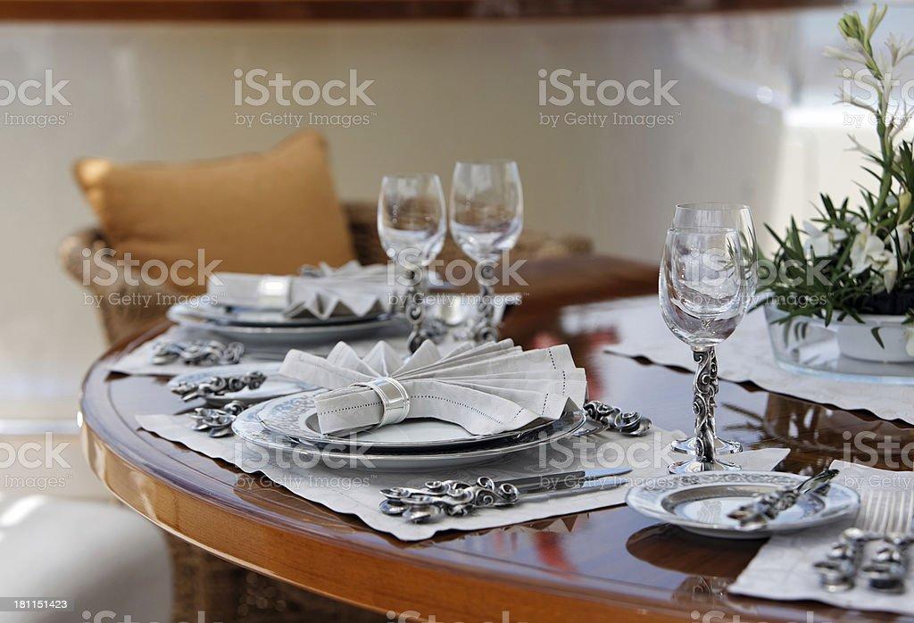 Elegant table setting in luxury boat royalty-free stock photo
