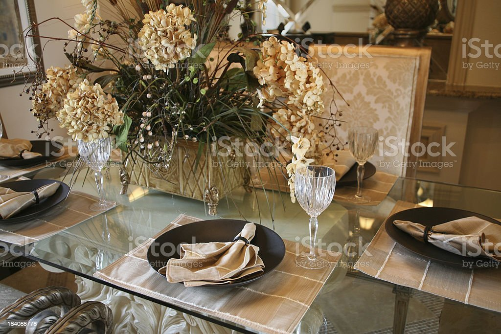 Elegant Table with Floral Arrangement royalty-free stock photo
