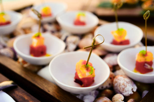 Elegant tapas by the sea in the sunset stock photo
