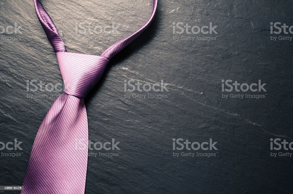 Elegant tie on dark background stock photo