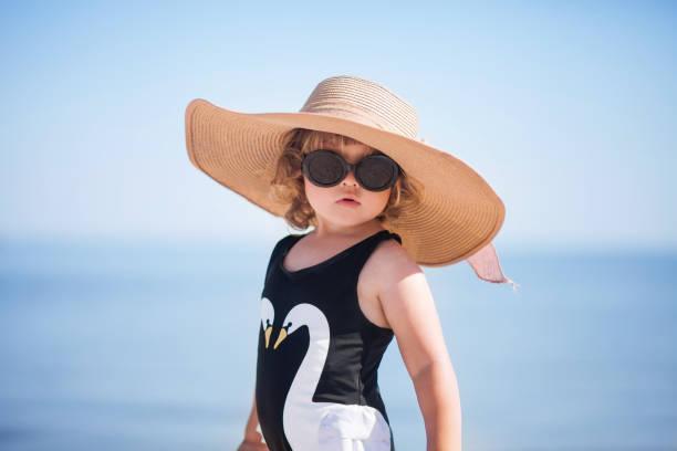 Elegant toddler girl at the beach. stock photo