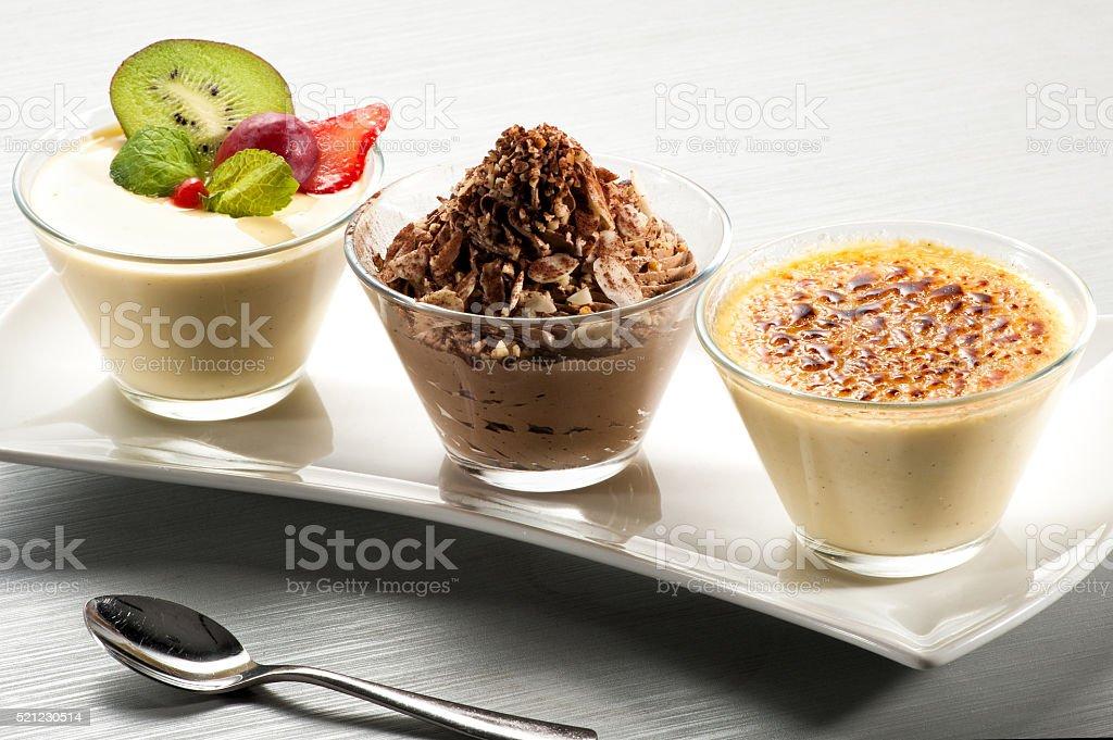 Elegant tray of desserts in glasses stock photo