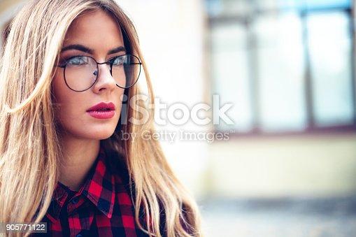 870648602 istock photo Elegant, trendy outfit Closeup portret of Fashionable girl on the street. Female fashion.stylish woman. 905771122