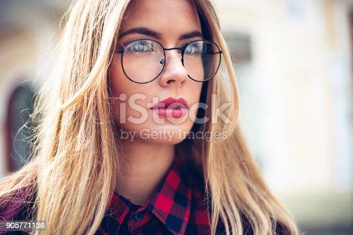 870648602 istock photo Elegant, trendy outfit Closeup portret of Fashionable girl on the street. Female fashion.stylish woman. 905771136