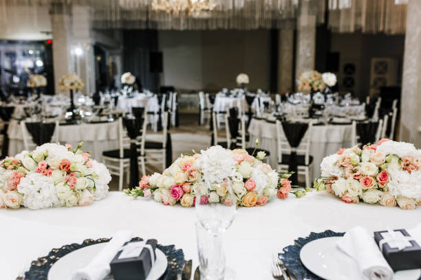 Elegant Wedding Reception table decor and centerpieces. Restaurant decor for event with natural roses stock photo