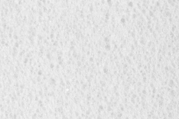 elegant white ethylene vinyl acetate foam texture - spugna per le pulizie foto e immagini stock