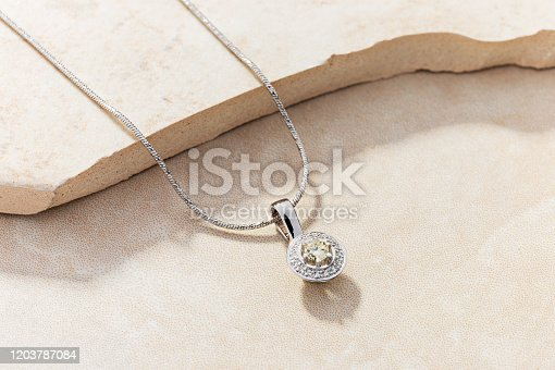 Elegant white gold necklace with diamonds. Small silver charm necklace with gemstones