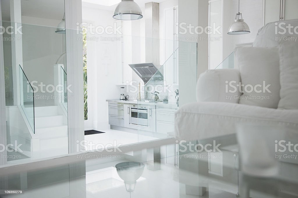 Elegant white living room and stainless steel kitchen stock photo
