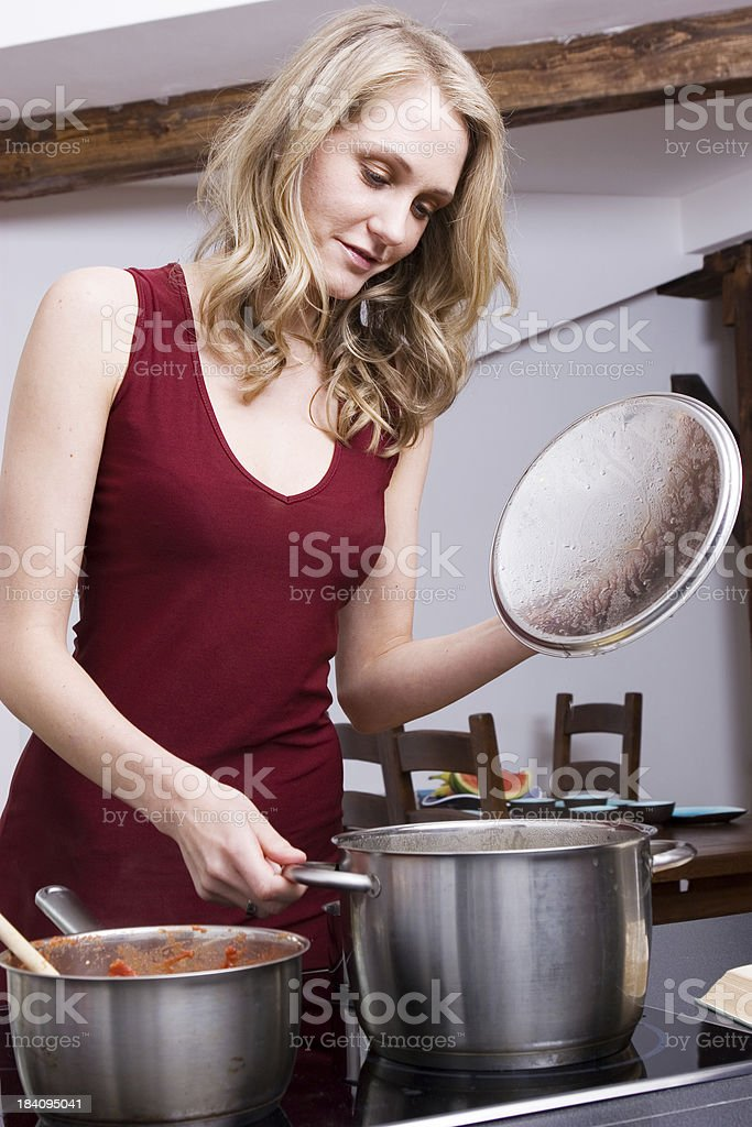 Elegant woman cooking royalty-free stock photo