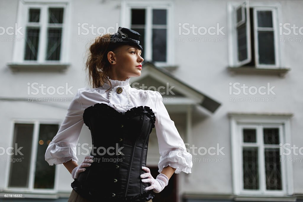 Elegant woman dressed in retro victorian style stock photo