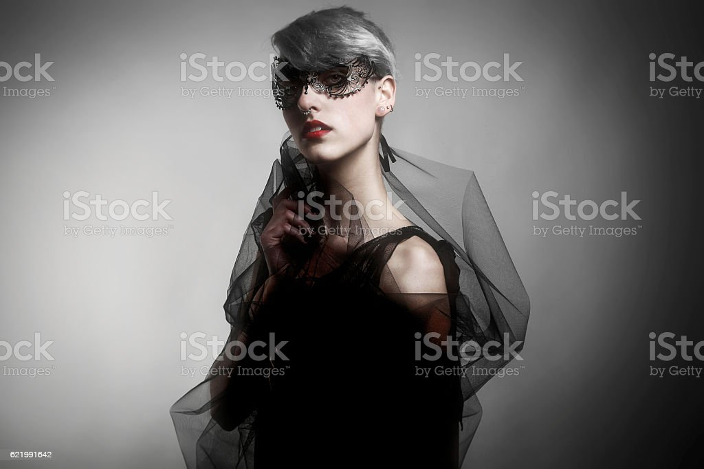 Elegant Woman Dressed in Tulle and Carnival Mask stock photo