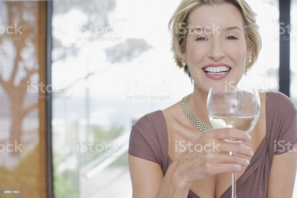 Elegant woman drinking white wine royalty-free stock photo