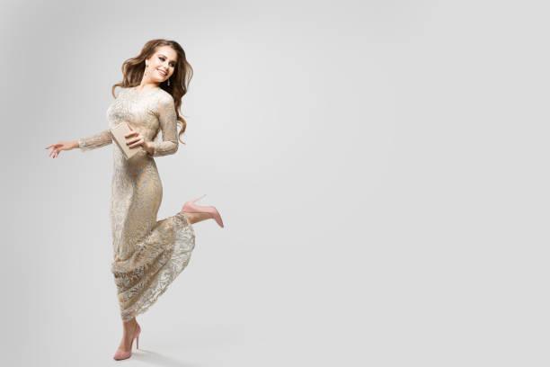 Elegant Woman Evening Sparkling Dress, Happy Fashion Model in beautiful Gown, Beauty Studio Portrait stock photo