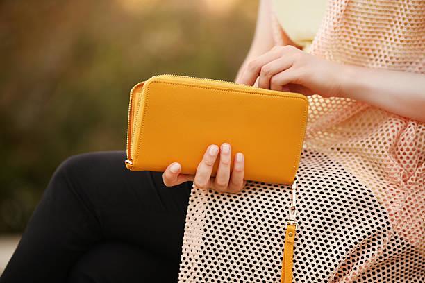 elegant woman holding red handbag clutch bag - kinderhandtaschen stock-fotos und bilder