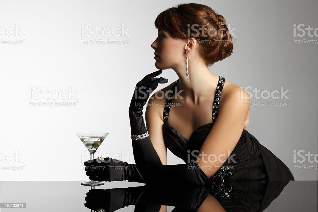 Elegant woman in black gloves holding martini royalty-free stock photo